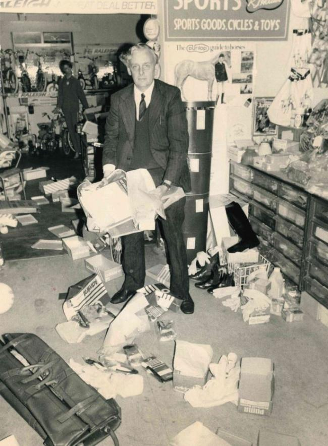Raymond Hollier cleans up the mess left behind by burglars at Headington Sports Shop, in August 1977