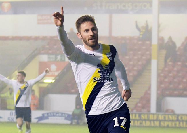 James Henry celebrates scoring Oxford United's winner at Walsall  Picture: David Fleming