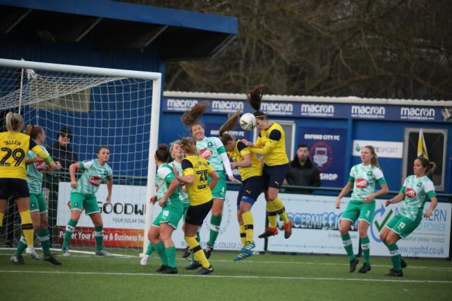 Gemma Sims heads home the first of her two goals for Oxford United in their Women's FA Cup defeat against Plymouth