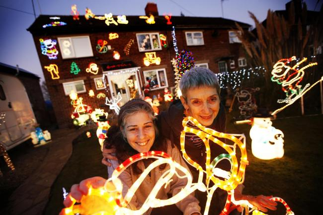 Dawn and Jackie Jackson with their Christmas display of 3,500 lights in Bloxham near Banbury. Picture: Ed Nix