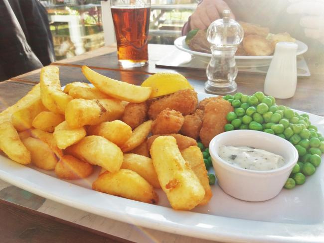 Above: scampi, chips and peas. Left: the sunlit conservatory.      Picture: Pete Hughes