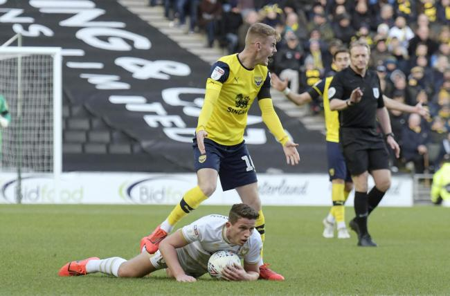 Oxford United's Mark Sykes shows his frustration after conceding a free-kick against MK Dons  Picture: David Fleming