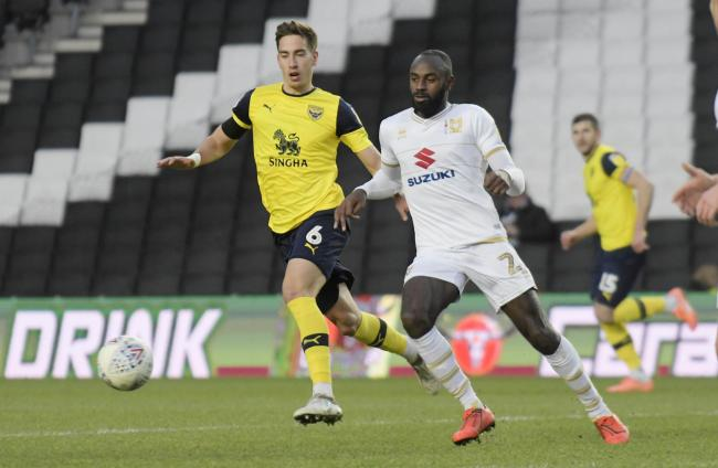 Oxford United's Alex Gorrin closes down MK Dons forward Hiram Boateng  Picture: David Fleming