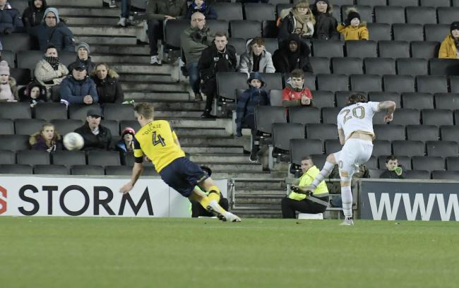 Joe Mason scores the only goal of the game as Oxford United lost at MK Dons  Picture: David Fleming