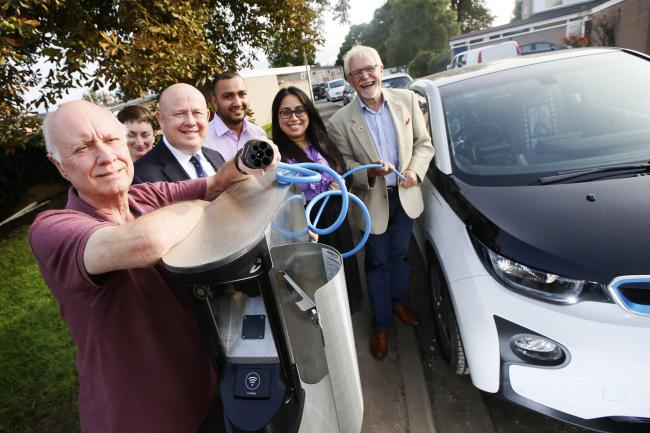 The launch of the Go Ultra Low residential charging points in 2017. Left-to-right: Leslie Horne, Jo Colwell, Ian Hudspeth, residents Yousef and Ruby Mehmood and county councillor John Tanner. Picture: Ed Nix
