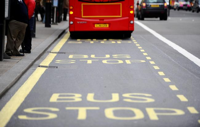 A stock picture of a bus at a bus stop on Parliament Street in London..