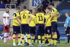 Cameron Brannagan (centre) talks with Oxford United teammates during a stoppage in the defeat to Rotherham United   Picture: David Fleming