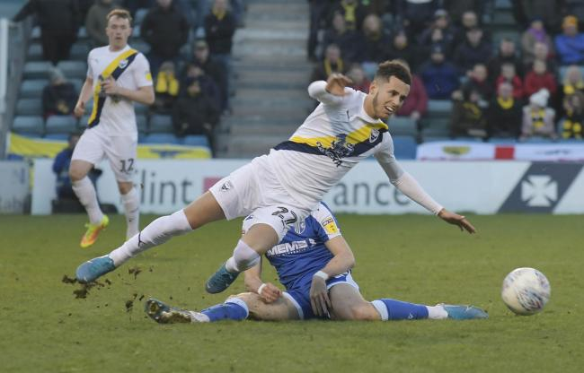 Nathan Holland is tackled in Oxford United's draw at Gillingham  Picture: David Fleming
