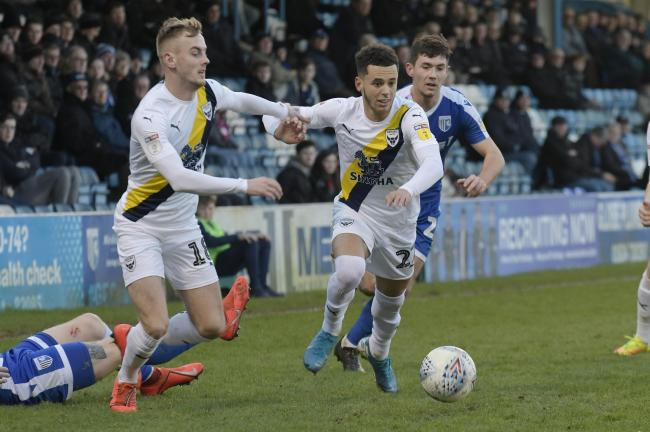 Oxford United's Nathan Holland (right) and Mark Sykes on the attack in the first half at Gillingham   Picture: David Fleming