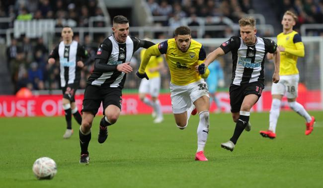 Marcus Browne takes on two Newcastle United defenders in Oxford United's goalless draw in the Emirates FA Cup on Saturday   Picture: Richard Parkes