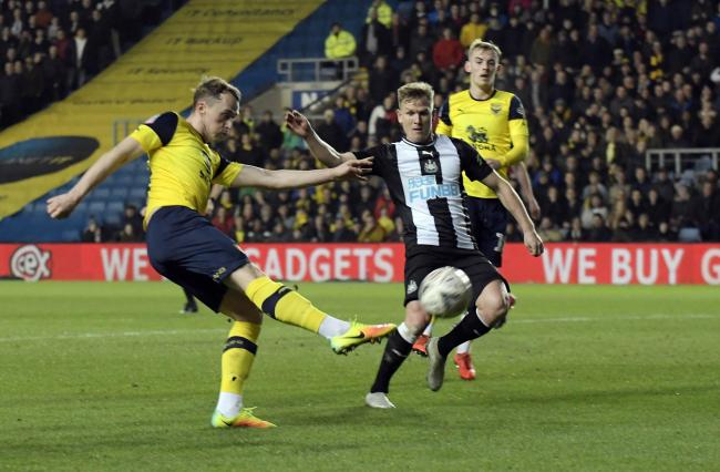 Oxford United's Sam Long lets fly with a shot which was cleared off the line  Picture: David Fleming