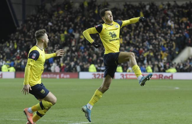Nathan Holland celebrates Oxford United's stoppage-time equaliser against Newcastle United  Picture: David Fleming