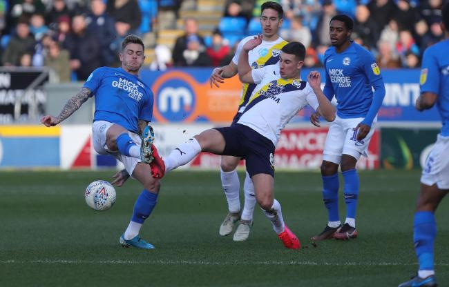 Cameron Brannagan puts a tackle in during Oxford United's hammering at Peterborough United   Picture: Richard Parkes