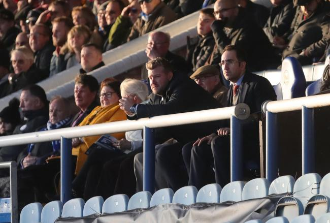 Karl Robinson looks on from the stands during Oxford United's 4-0 defeat at Peterborough United Picture: Richard Parkes