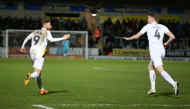 Matty Taylor (left) celebrates his goal for Oxford United at Burton Albion with Rob Dickie   Picture: Richard Parkes