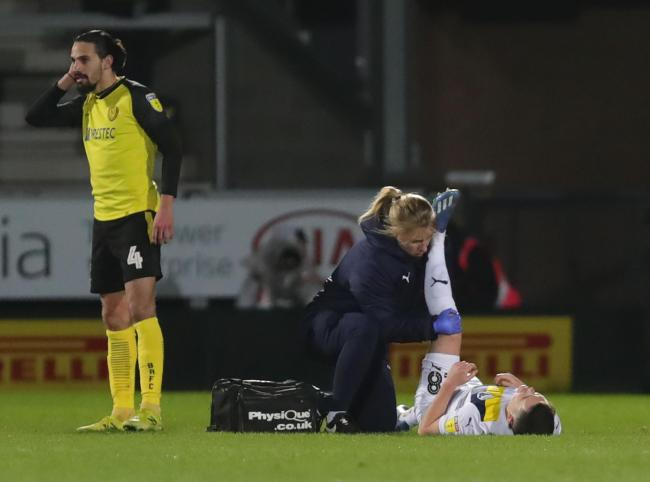 Oxford United's Liam Kelly receives treatment on the pitch at Burton Albion on Tuesday night  Picture: Richard Parkes