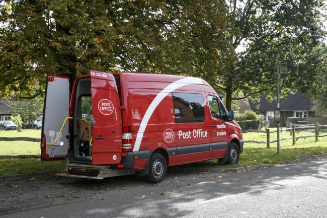 File photo of a mobile post office van.