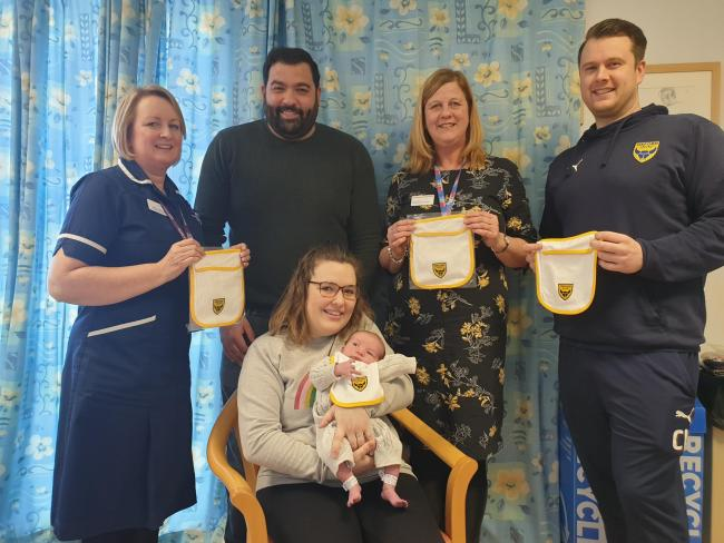 Jane Hamilton, Ward Manager; baby Buzz Jones and family; Jane Upham, Clinical Midwifery Manager; and Chris Lowes, Head of Oxford United in the Community