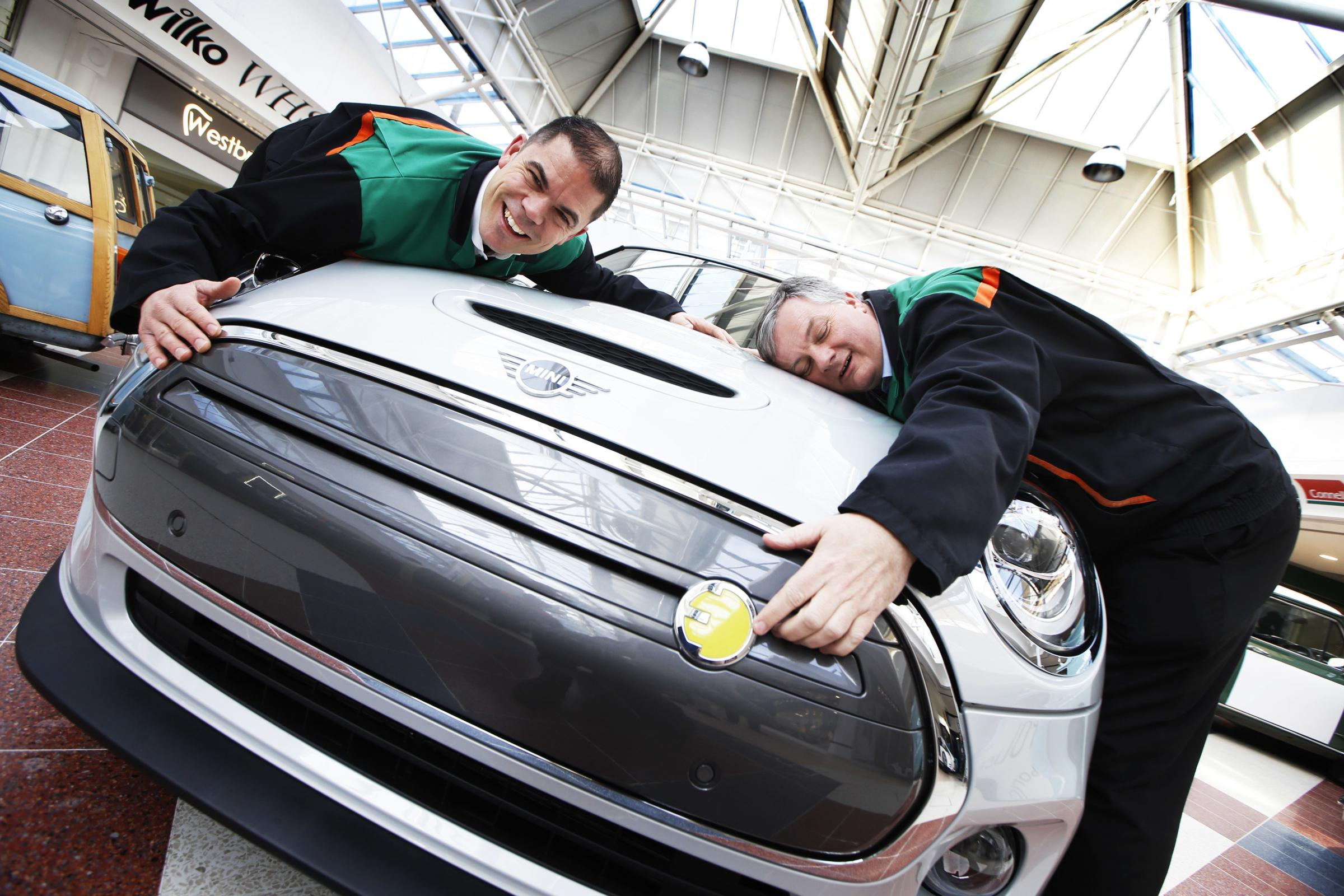 Car plant workers embrace the new electric Mini