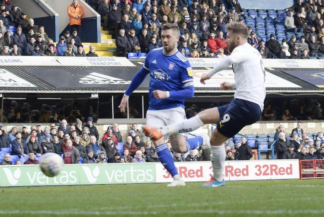 Matty Taylor slots in Oxford United's winner at Ipswich Town   Picture: David Fleming