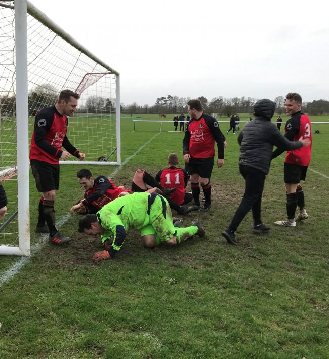 Watlington Town players celebrate their epic penalty shoot-out win over Hailey Picture: Keith Woolfson