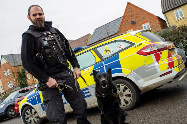 PC Wayne Mills and police dog Cody. Pic from Thames Valley Police federation