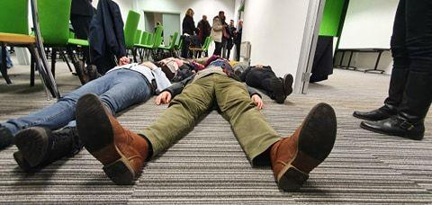 Extinction Rebellion held a die-in protest after the council meeting.
