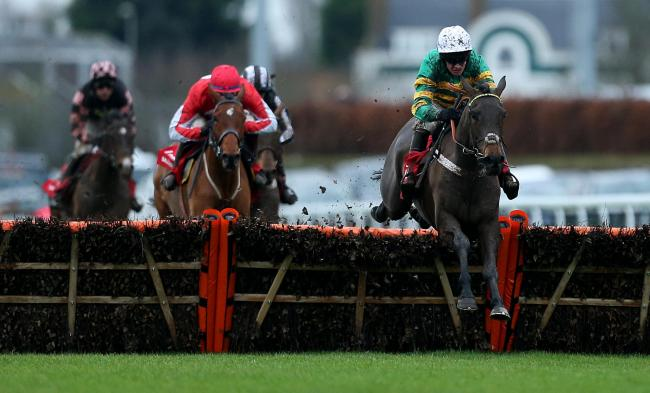 Epatante (right) ridden by jockey Barry Geraghty goes on to win the Ladbrokes Christmas Hurdle during day one of the Winter Festival at Kempton Park last December   Picture: PA Wire