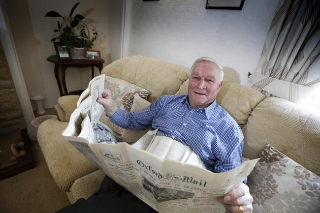 Peter Stevens of Chadlington with his Oxford Mail copy from 1928. Picture: Ed Nix