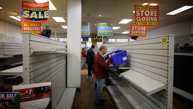 Shoppers clear the shelves as Woolworths in Templars Square, Cowley, closes for the last time in January 2009. Picture: Damian Halliwell