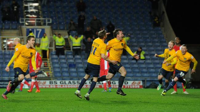 David Connolly (centre) celebrates his winner against Hartlepool United in 2014  Picture: Jon Lews
