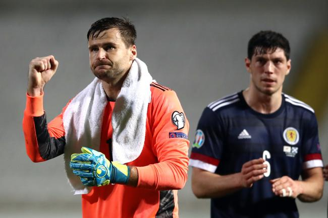 Scotland goalkeeper David Marshall hopes to see injured team-mates like Scott McKenna (right) back fit when they do finally get the green light to face Israel