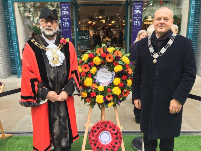 The Lord Mayor of Oxford, Craig Simmons, and the Burgomaster of Leiden, Henri Lenferink, lay a Dutch-style floral wreath by the Oxford-Leiden mosaic in Leiden Square in the Westgate Centre to mark Remembrance Day in November 2019.