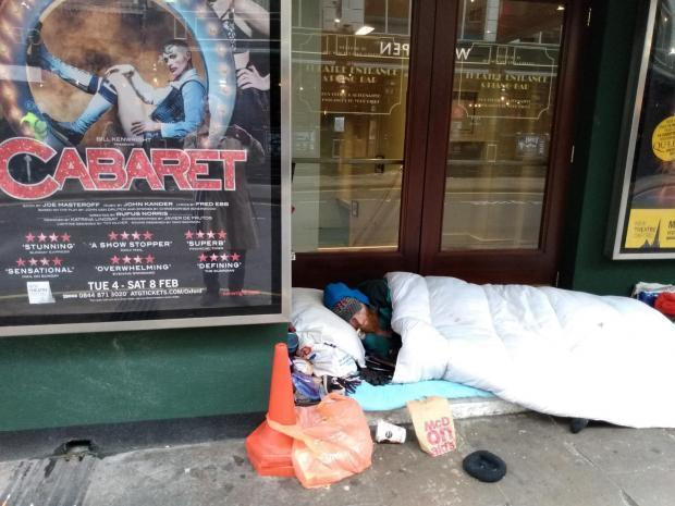 A rough sleeper outside the New Theatre in George Street