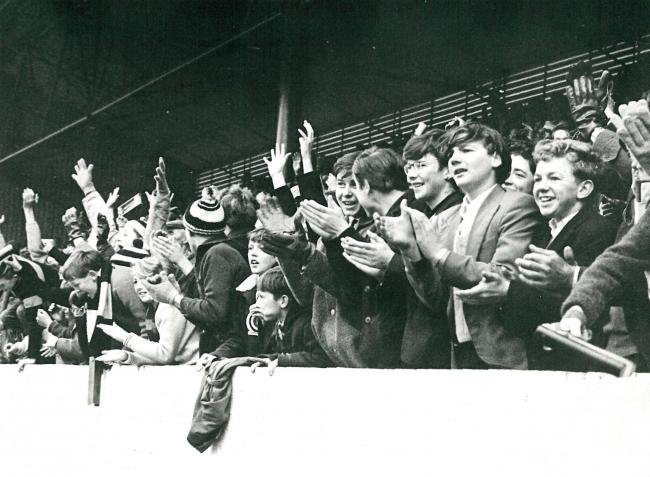 Oxford United fans celebrate a goal against Chester City at the Manor Ground during the promotion season
