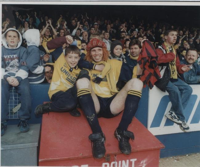 Martin Gray celebrates promotion in the London Road end in May 1996 Picture: George Reszeter