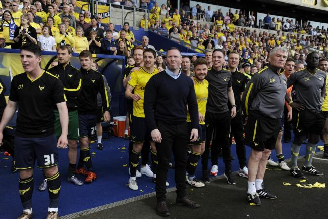 Oxford United head coach Michael Appleton waits with players and backroom staff for the final whistle to confirm their promotion on this day four years ago  Picture: David Fleming