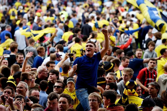 Oxford United fans invade the pitch to celebrate promotion   Picture: David Fleming
