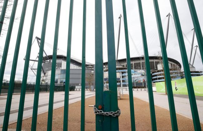 Locked gates outside the Etihad Stadium, home of Manchester City    Picture: Martin Rickett/PA Wire
