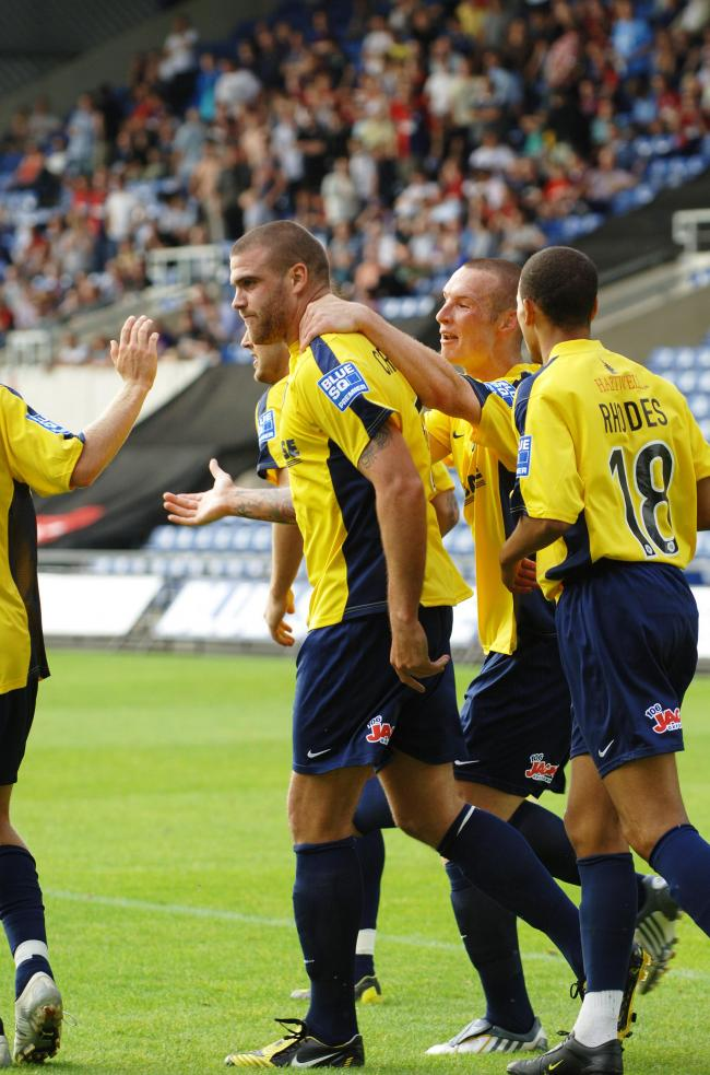 Mark Creighton is congratulated after scoring a late winner against York City on the opening day Picture: Jon Lewis