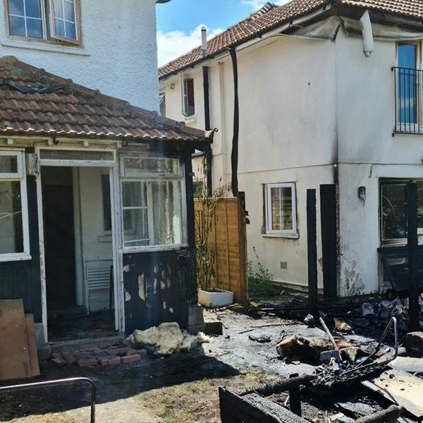 Firefighters race to stop shed fire spreading to houses