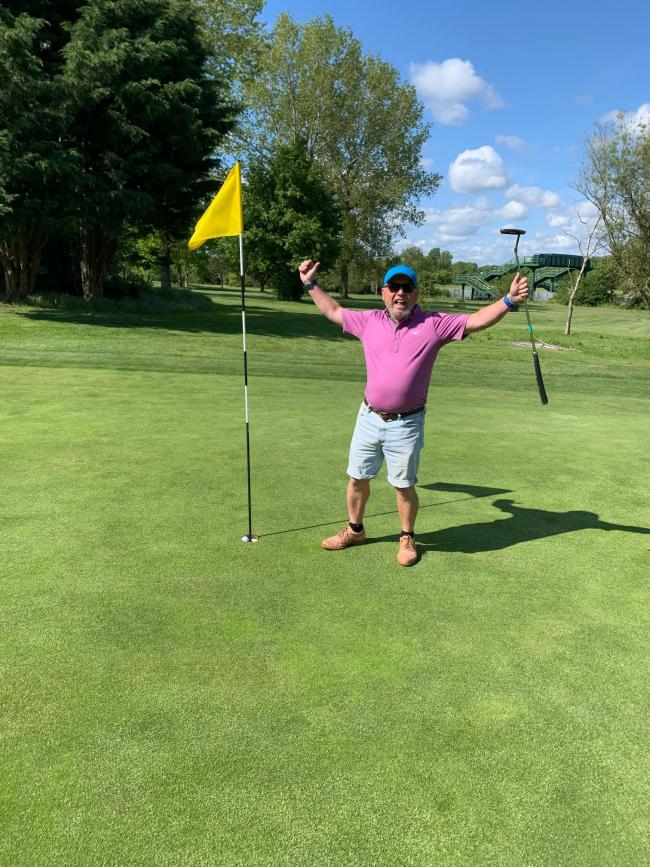 Paul Clarke celebrates his hole in one