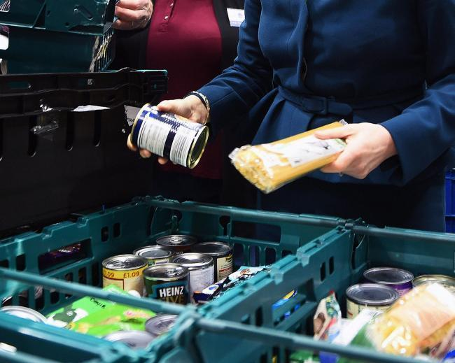 Stock image of food parcels at a food bank.