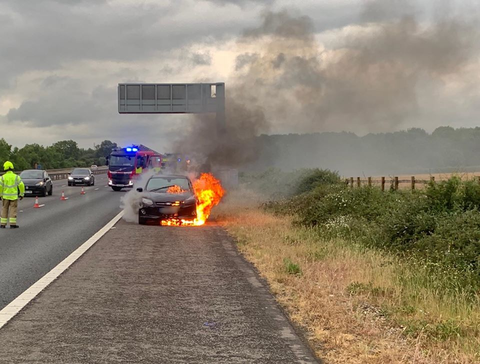 Fire crews scrambled to car in flames on M40