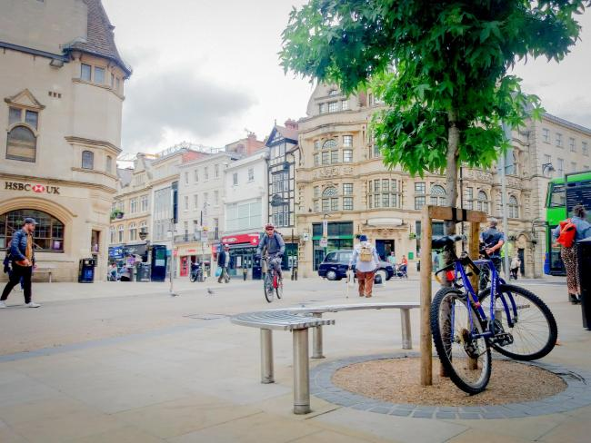 A growing number of cyclists and pedestrians at Carfax, Oxford, yesterday lunchtime. 						               Picture: Pete Hughes