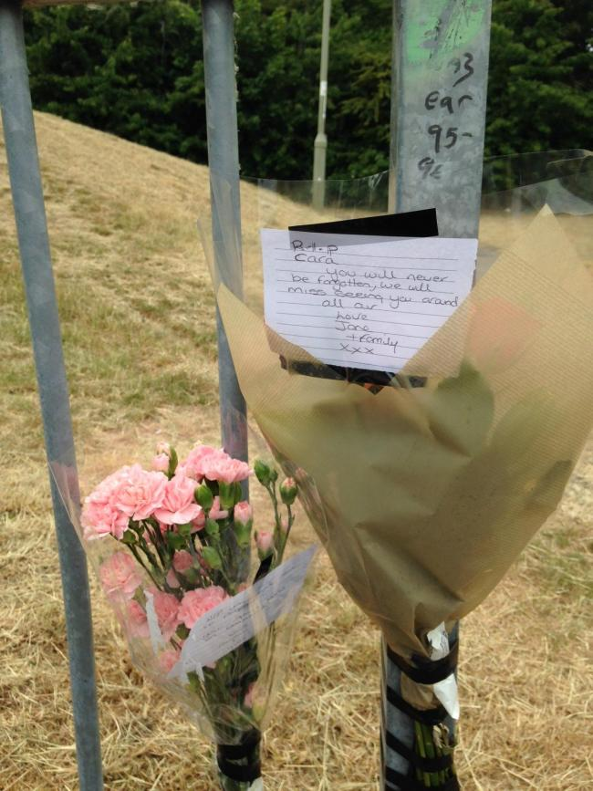 Flowers and tributes left at the scene on Thomson Terrace, Littlemore
