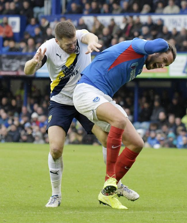 Christian Burgess tangles with Jamie Mackie in Oxford United's league meeting with Portsmouth in November   Picture: David Fleming