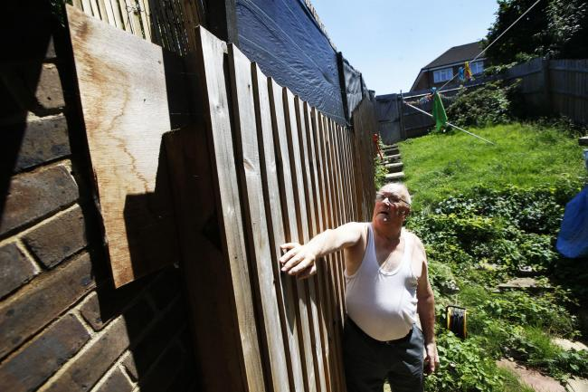 Martin Lovegrove has been waiting for more than a year for Oxford City Council to fix his fence. Picture: Ed Nix