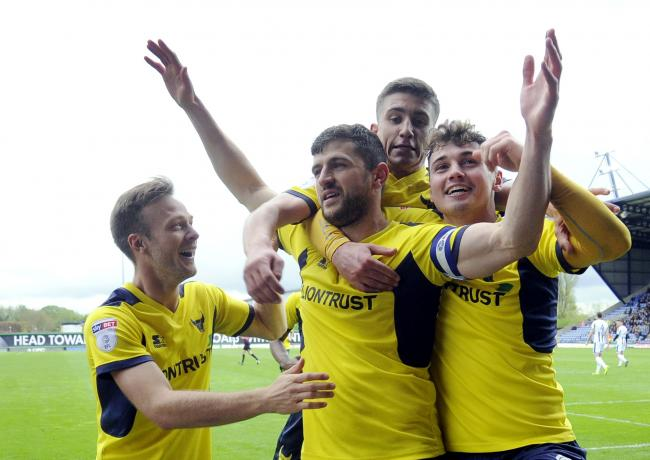 John Mousinho is congratulated after his nerveless penalty for Oxford United against Rochdale in 2018   Picture: David Fleming