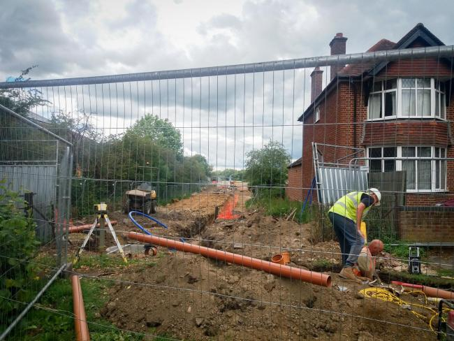 Workmen pictured from Botley Road digging a trench in the field to the east of Seacourt Park and Ride. Picture: Pete Hughes